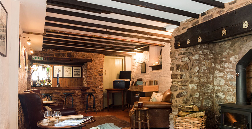 Rustic country inn and bar area with open fireplace